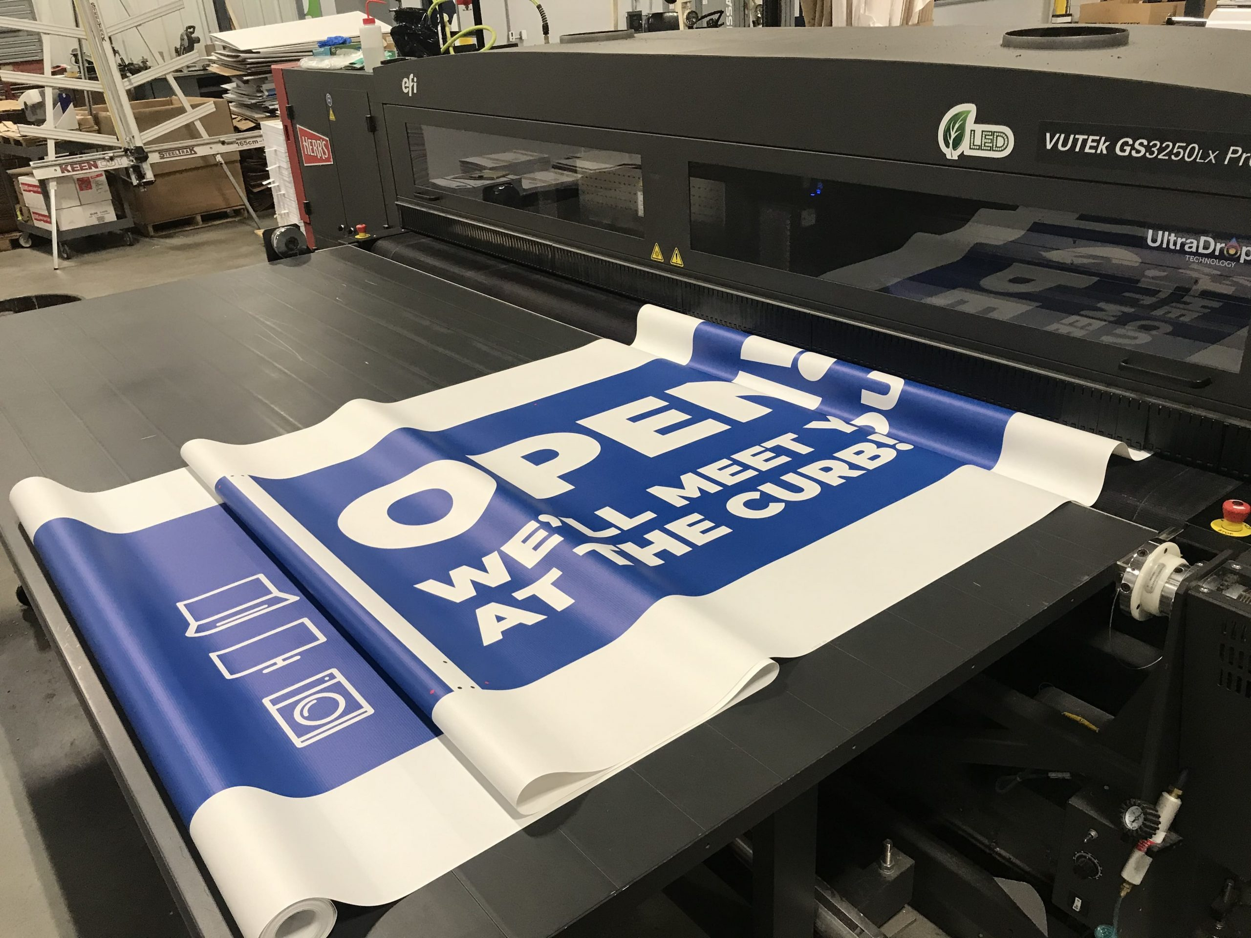 Custom banner being printed by The Anstadt Company